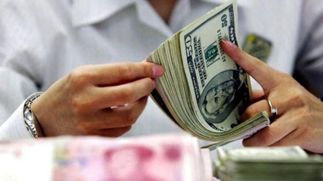 人民币贬值压力大 分析师:半年内汇率会破7